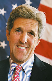 202px John Kerry headshot with US flag John Kerry News