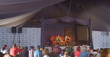 Cainer on stage at the 2013 Latitude Festival