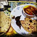 Kadhi, Bharwan baigan, papad, roti and dahi.jpg