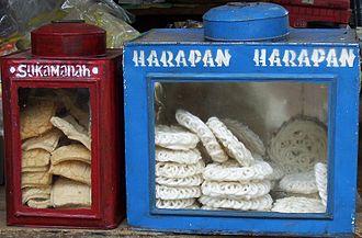 Krupuk - Krupuk gendar (brown rice cracker) and krupuk kampung or krupuk putih (cassava starch crackers) in air-tight containers