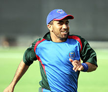 Cricketer Karim Sadiq, running and smiling