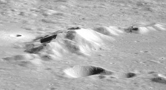 Keeler (lunar crater) - The central peak from Apollo 11.  The highest peak is approximately 3.5 km above the crater floor.