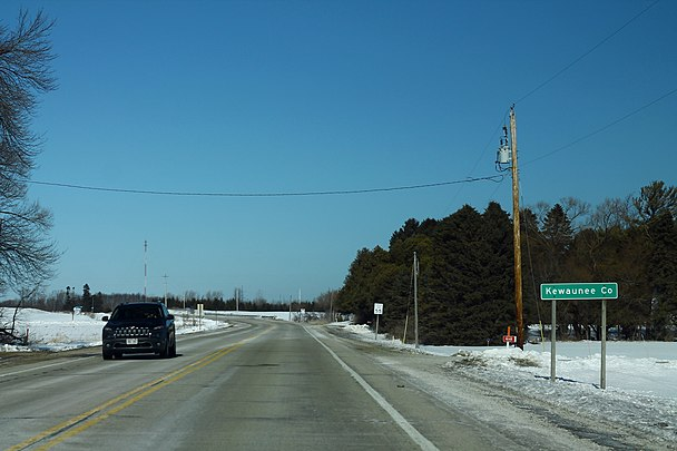 Kewaunee County sign on Highway 42, at the border with Manitowoc County