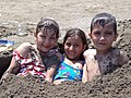 Kids in the Sand - Beach at Bandar-e Anzali- Northwestern Iran (7418485898).jpg