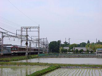 Kashihara Line - A Kashihara Line train passing Yakushi-ji temple