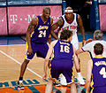 Kobe Bryant and Al Harrington waiting for a jump ball.jpg