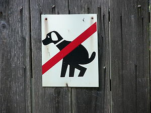 Signboard on a fence in Sausalito, CA: dog shi...