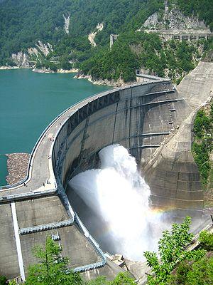 Kurobe Dam - View of Kurobe Dam, orifice floodgates discharging water
