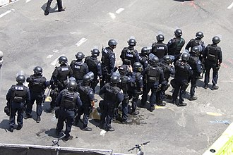 Militarization of police - A large group of Los Angeles Police Department (LAPD) SWAT officers in tactical gear at a Lakers parade in 2009