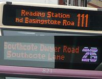 LED destination displays on buses, one with a colored route number.