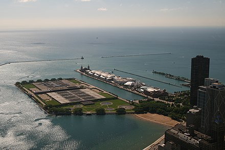 An east-southeast view in Chicago, Illinois overlooking the Jardine Water Purification Plant and Navy Pier within the Chicago Harbor including the north and south breakwaters and the Chicago Harbor Lighthouse Lake Michigan and the Navy Pier.jpg