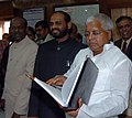 Lalu Prasad giving finishing touches to the Railway Budget 2006-07 in New Delhi on February 23, 2006. The Ministers of State for Railways Shri Naranbhai Rathwa and Shri R. Velu are also seen.jpg