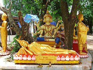 Lao people - A statue of Lord Brahma (background) at a temple in Vientiane.