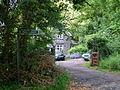 Lasgarn Cottage and footpath sign to Lasgarn Wood - geograph.org.uk - 469485.jpg
