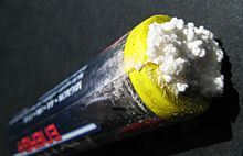 Potassium carbonate, formed from the hydroxide solution leaking from an alkaline battery