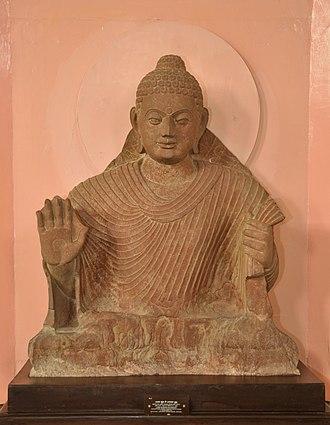 Abhayamudra - Buddha with his right hand in abhaya mudra.