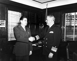 Leo J. Dulacki - Dulacki (left) receives Bronze Star Medal by Vice admiral Robert P. Briscoe, Commander Naval Forces Far East, for his service in Korea.