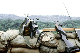 M79 grenade launcher - M79 (right) with an FN minimi, Panama, January 1989