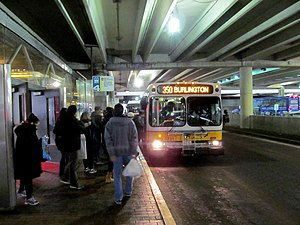 Alewife (MBTA station) - A route 350 bus boarding at Alewife in 2017