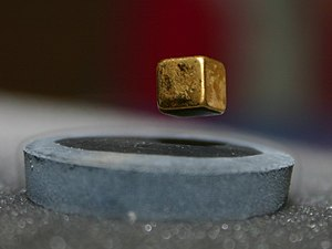 Levitation - A cubical magnet levitating over a superconducting material (known as the Meissner effect)