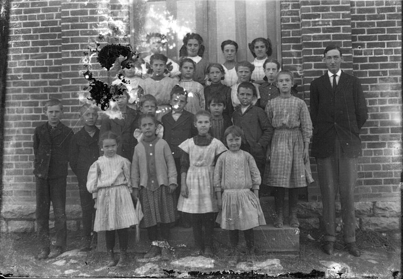 File:Man with group of children n.d. (3191870657).jpg