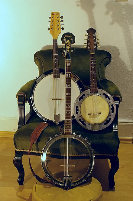 Two styles of mandolin-banjo, showing a large and small head, with a full size, four-string banjo (bottom).
