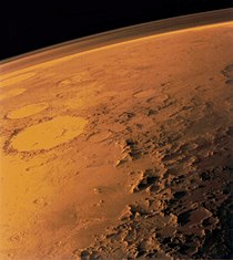 Mars' thin atmosphere, visible on the horizon in this low orbit photo.