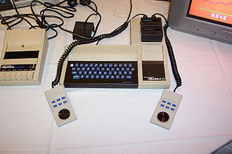 Mattel Aquarius - The Aquarius with attached expansion block including 4KB RAM expansion and game cartridge inserted, controllers, and tape Data Recorder