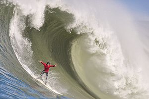 Surfer takes on a massive wave in Halfmoon Bay...