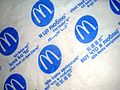 McDonalds wrapping paper with various languages, Bucharest, Romania.JPG