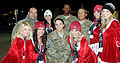 Members of the Arizona Cardinals cheerleading squad pose with U.S. Army Soldiers preparing to deploy to Afghanistan, outside Freedom Crossing, at Fort Bliss, Texas, Dec. 15, 2011 111215-A-KJ276-006.jpg