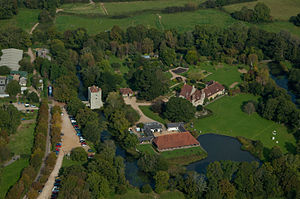 Michelham Priory - Aerial view of Michelham Priory. Barbican tower (centre left), dovecot (centre), refectory (centre right), watermill (bottom left) and barn (bottom centre)