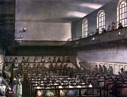 Conservative Friends worshipping in London in 1809. Friends are in traditional plain dress. At the front of the meeting house, the Recorded Ministers sit on a raised ministers' gallery facing the rest of the meeting, with the elders sitting on the bench in front of them, also facing the meeting. Men and women are segregated, but both are able to minister. Microcosm of London Plate 064 - Quakers' Meeting (tone).jpg