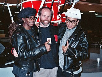 Milli Vanilli - Fab Morvan (left) and Rob Pilatus (right) with NARAS President C. Michael Greene (center), February 1990