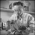 Minidoka Relocation Center, Minidoka, Washington. Radio repair shop. Henry Tambora, radio repairman. - NARA - 536541.tif