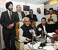 Mohd. Hamid Ansari addressing the onboard media on his way to London after visiting Cuba and Peru on October 31, 2013. The Minister of State for Human Resource Development, Shri Jitin Prasada is also seen.jpg