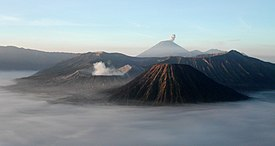 Mount Bromo at sunrise, showing its volcanoes and Mount Semeru (background).jpg