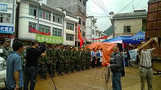 2014 Ludian earthquake - Mourning held in Baogunao (包谷垴乡) for victims in Ludian earthquake on 8 August 2014.