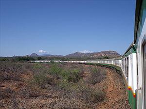 Kenya Railways Corporation - The Nairobi - Mombasa overnight train with Kilimanjaro on the horizon.