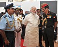 Narendra Modi at 'Shauryanjali', a commemorative exhibition on Golden Jubilee of 1965 war, at India Gate, in New Delhi. The Chief of the Air Staff, Air Chief Marshal Arup Raha and the Chief of Army Staff.jpg
