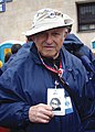 Nate-Leipciger -Holocaust-survivor -marching-in-memory-of-his-mother -whose-picture-he-is-holding.jpg