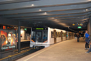 Transport in Norway - The Oslo T-bane is the backbone of public transport in Oslo, here at Nationaltheateret metro station.
