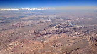 Petrified Forest National Park - Aerial view looking south from the Navajo Reservation (foreground) across the Painted Desert, the Petrified Forest National Park, and Adamana, Arizona