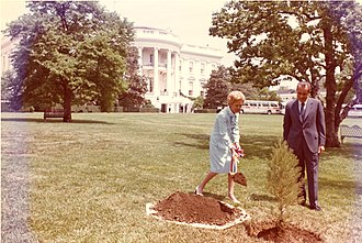 Earth Day - President Richard Nixon and First Lady Pat Nixon plant a tree on the White House South Lawn to recognize the first Earth Day.