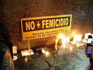 Femicide - A candle memorial to women killed by femicide (femicidio), Chile, 2007.