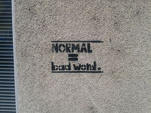 "Norm (social) - ""Normal is a bad word"", a graffito in Ljubljana, Slovenia"