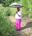Old woman with umbrella Sri Lanka.JPG