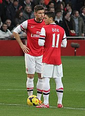 Giroud And Mesut Ozil Before Kick Off Against Southampton In November 2013