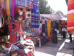 Otavalo (city) - The Saturday market in Otavalo, showing the colourful fabrics