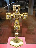 Golden cross on a pedestal with inlayed gems